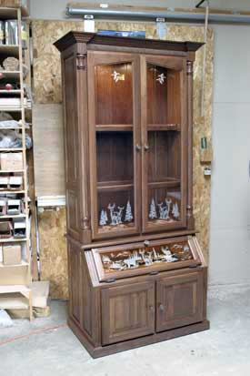 Custom gun cabinets and gunsafes specialty designs panel doors and drawers walnut gun cabinet with etched glass teraionfo