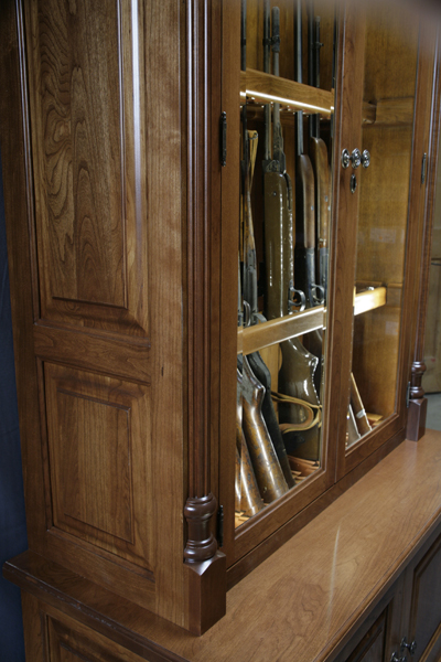 Delicieux This Gun Cabinet Features Cherry Rope Molding And Columns, Flush Mount  Doors, And LED Touch Lighting.